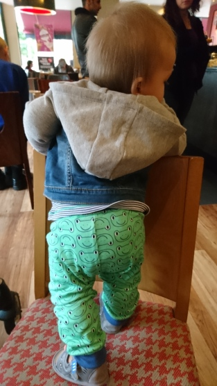 Showing off his froggy leggings before choir